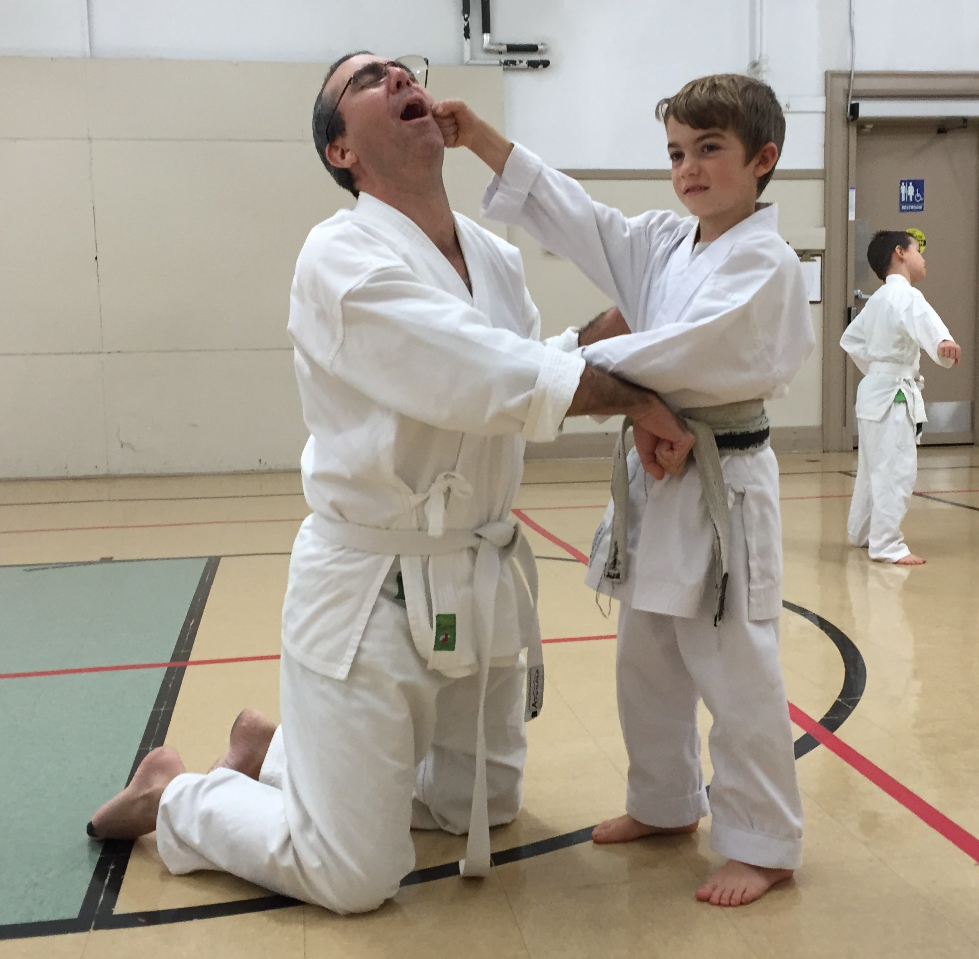 Sensei Frank and a youth student have some fun during a karate class